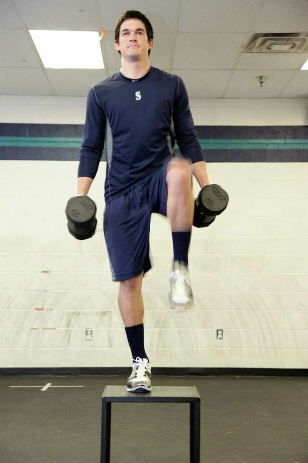 Seattle Mariners pitcher Anthony Vasquez, a former Reagan High standout, works in the weight room last month. He's working to get back to the major leagues after life-saving surgery. Photo: Courtesy Photo / Jason Wise