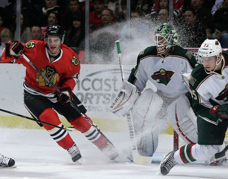 The Blackhawks peppered Wild goalie Niklas Backstrom with 32 shots, and Brandon Saad, left, threw in a spray of ice for good measure. Photo: Brian Cassella, MBR / Chicago Tribune