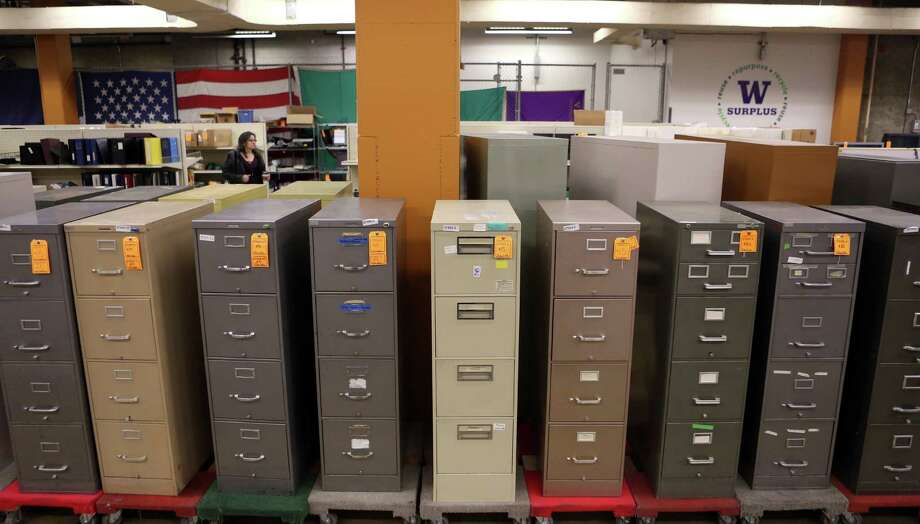 Rows of file cabinets are shown at the University of Washington Surplus Store on Tuesday, March 5, 2013. The store sells items no longer being used by the university, often at rock bottom prices. Photo: JOSHUA TRUJILLO / SEATTLEPI.COM