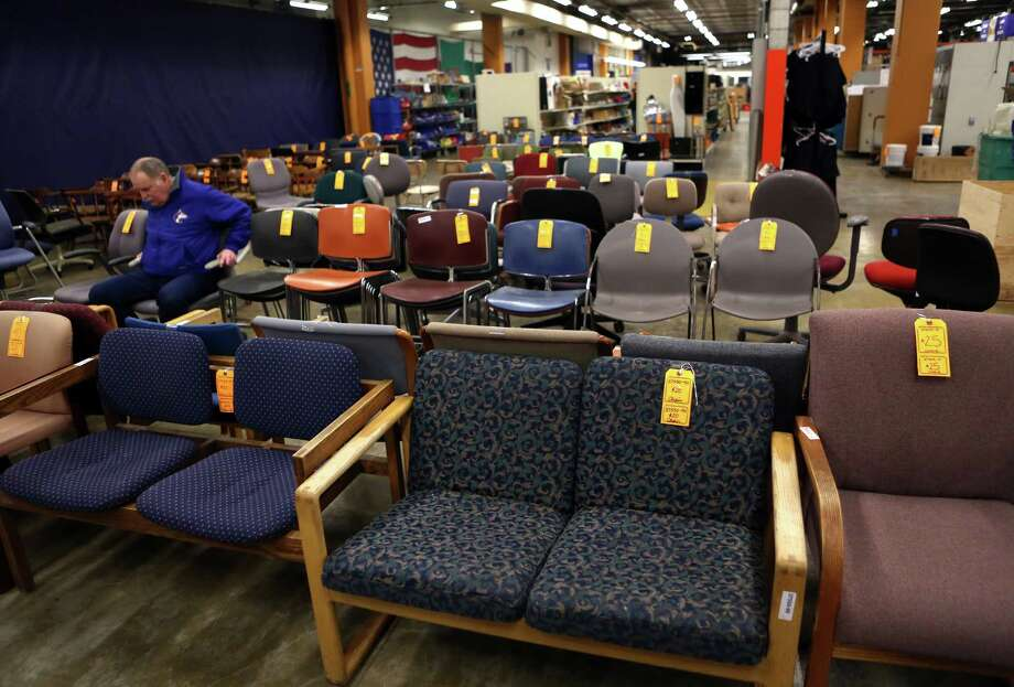 Rows of chairs are shown at the University of Washington Surplus Store on Tuesday, March 5, 2013. The store sells items no longer being used by the university, often at rock bottom prices. Photo: JOSHUA TRUJILLO / SEATTLEPI.COM