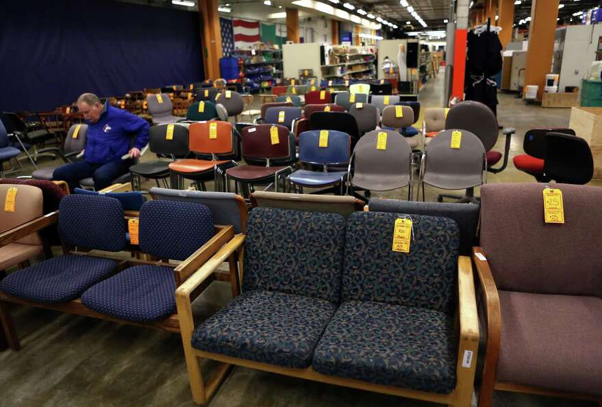 Rows of chairs are shown at the University of Washington Surplus Store on Tuesday, March 5, 2013. Th