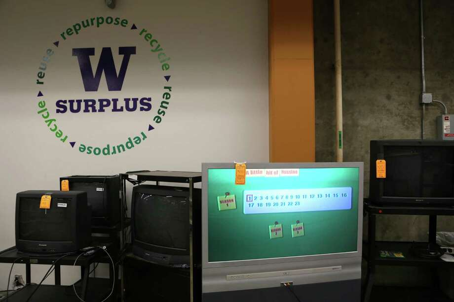Televisions are shown for sale at the University of Washington Surplus Store on Tuesday, March 5, 2013. The store sells items no longer being used by the university, often at rock bottom prices. Photo: JOSHUA TRUJILLO / SEATTLEPI.COM