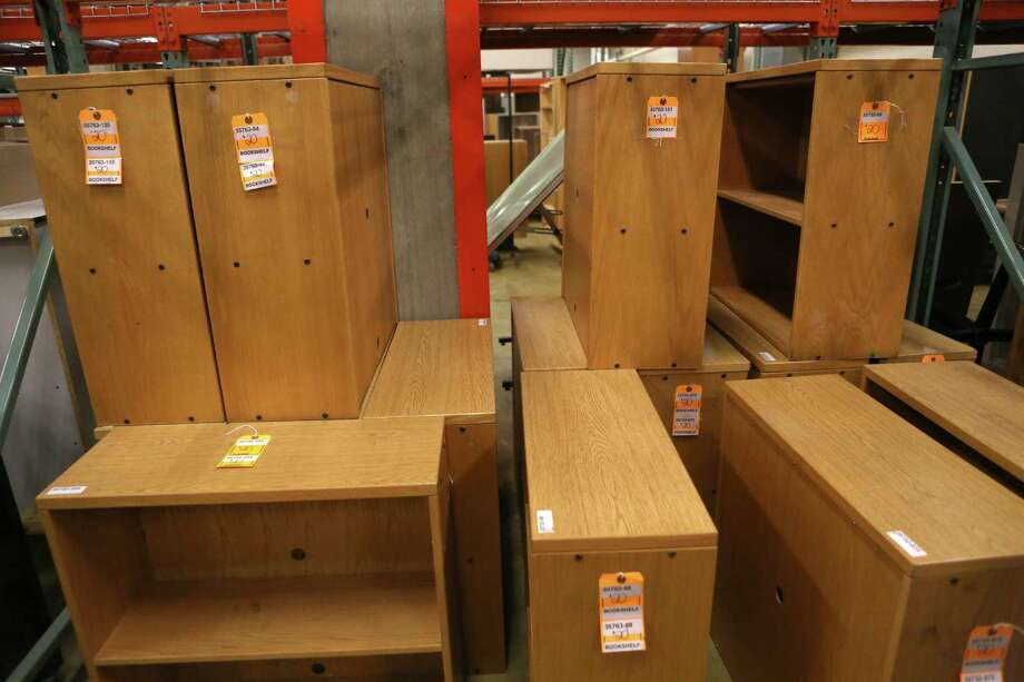 Bookshelves are shown for $20 at the University of Washington Surplus Store on Tuesday, March 5, 2013. The store sells items no longer being used by the university, often at rock bottom prices. Photo: JOSHUA TRUJILLO / SEATTLEPI.COM