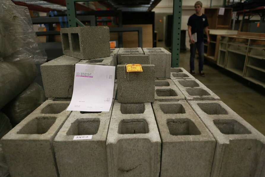 A pallet of cinderblocks is shown for $25 at the University of Washington Surplus Store on Tuesday,