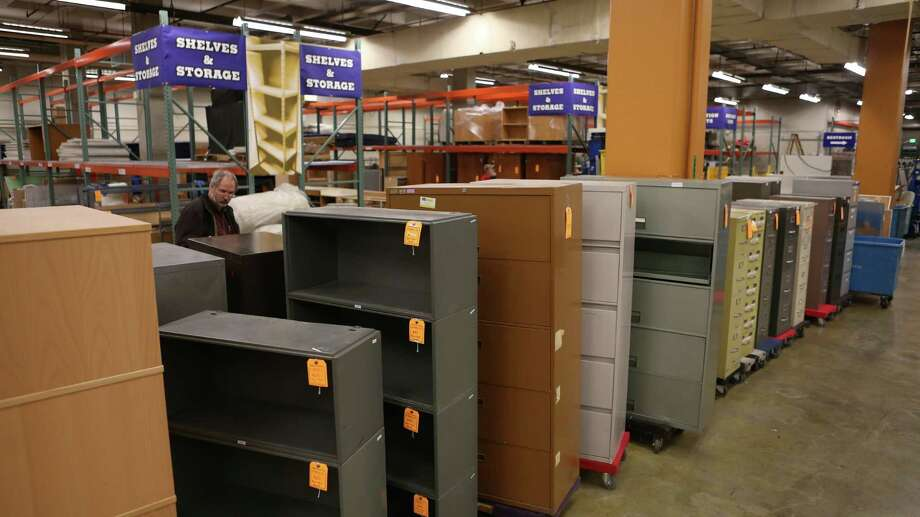 Shelves and cabinets are shown at the University of Washington Surplus Store on Tuesday, March 5, 2013. The store sells items no longer being used by the university, often at rock bottom prices. Photo: JOSHUA TRUJILLO / SEATTLEPI.COM