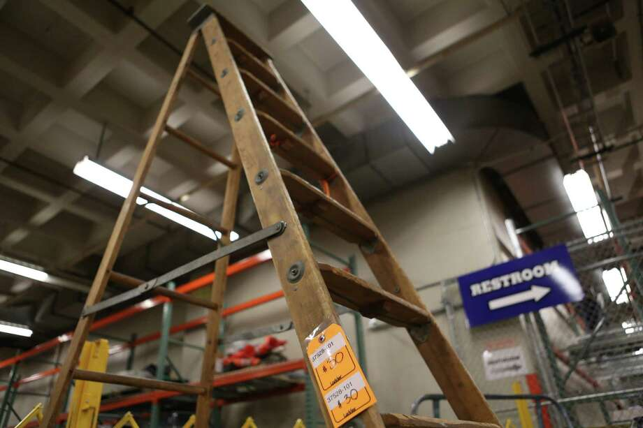 A large ladder sells for $30 at the University of Washington Surplus Store on Tuesday, March 5, 2013. The store sells items no longer being used by the university, often at rock bottom prices. Photo: JOSHUA TRUJILLO / SEATTLEPI.COM