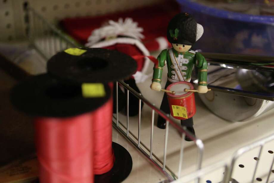 A figurine sells for 50 cents at the University of Washington Surplus Store on Tuesday, March 5, 2013. The store sells items no longer being used by the university, often at rock bottom prices. Photo: JOSHUA TRUJILLO / SEATTLEPI.COM