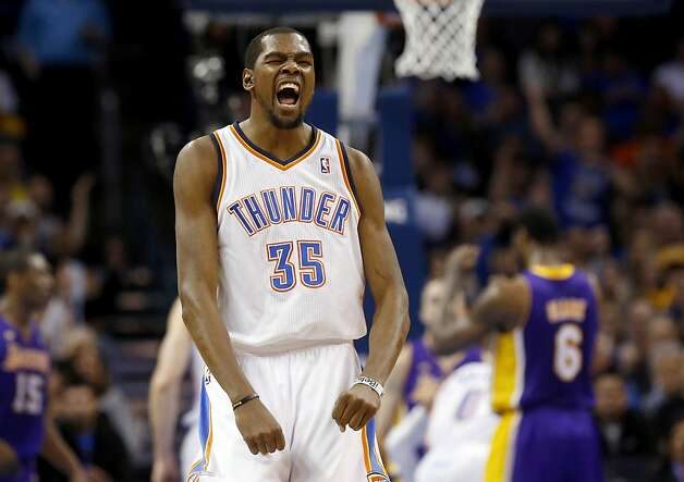 Kevin Durant rejoices after a teammate's first-half basket. Photo: Sue Ogrocki, Associated Press