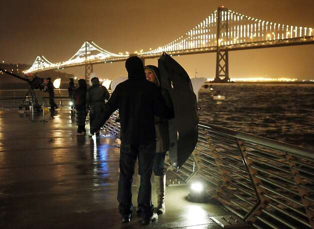 San Francisco prepared for the lighting of the Bay Lights art project on Tuesday, March 5, 2013, in anticipation of the Bay Bridge being illuminated by thousands of LED lights from the structural cables on Tuesday night. Photo: Carlos Avila Gonzalez, The Chronicle