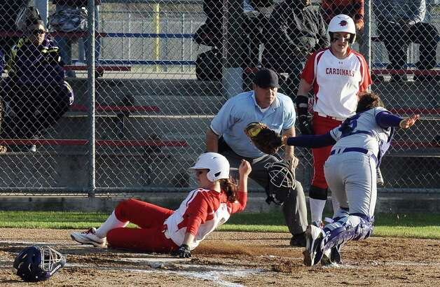 Lady Cardinal Candyce Carter, #3, slides into home safely during the Lamar University Lady Cardinals softball game against the Prairie View A&M Lady Panthers at Ford Fields in Beaumont on Tuesday, March 5, 2013.  Lady Cardinals won over the Lady Panthers 24 - 1. Photo taken: Randy Edwards/The Enterprise