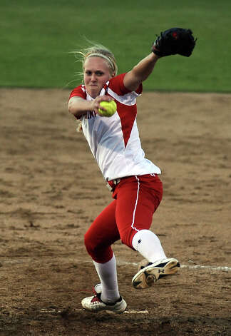Lady Cardinal Melissa Smith, #18, pitches the ball during the Lamar University Lady Cardinals softball game against the Prairie View A&M Lady Panthers at Ford Fields in Beaumont on Tuesday, March 5, 2013.  Lady Cardinals won over the Lady Panthers 24 - 1. Photo taken: Randy Edwards/The Enterprise