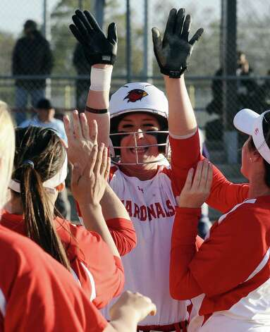 Lady Cardinal Ashley McDowell, #20, celebrates the first run of a long rally during the Lamar University Lady Cardinals softball game against the Prairie View A&M Lady Panthers at Ford Fields in Beaumont on Tuesday, March 5, 2013.  Lady Cardinals won over the Lady Panthers 24 - 1. Photo taken: Randy Edwards/The Enterprise
