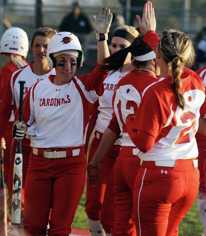 Lady Cardinal Casey Cromwell, #11, celebrates with her team on another run scored during the Lamar University Lady Cardinals softball game against the Prairie View A&M Lady Panthers at Ford Fields in Beaumont on Tuesday, March 5, 2013.  Lady Cardinals won over the Lady Panthers 24 - 1. Photo taken: Randy Edwards/The Enterprise
