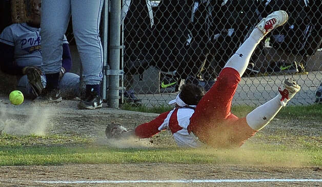 Lady Cardinal Stephanie Meeuwsen, #6, dives for foul tipped ball looking for an out during the Lamar University Lady Cardinals softball game against the Prairie View A&M Lady Panthers at Ford Fields in Beaumont on Tuesday, March 5, 2013.  Lady Cardinals won over the Lady Panthers 24 - 1. Photo taken: Randy Edwards/The Enterprise