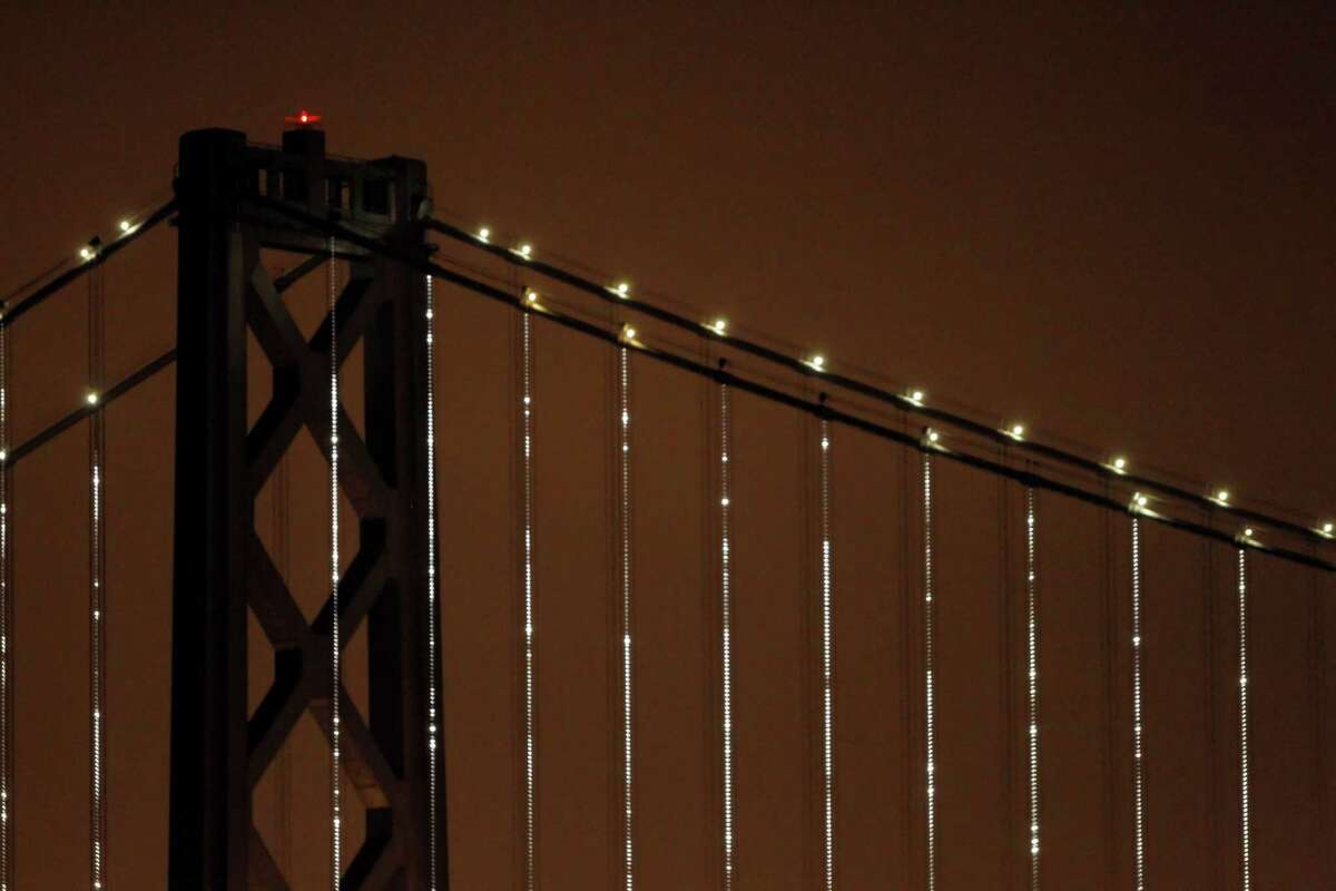 """""""Bay Lights"""" illuminates the cables of the Bay Bridge in March 2013."""