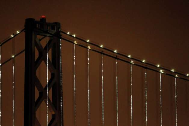 The Bay Lights art project illuminates the cables on the Bay Bridge on Tuesday, March 5, 2013. The LED art installation will be on display for two years. Photo: Carlos Avila Gonzalez, The Chronicle