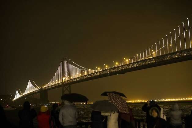 SAN FRANCISCO, CA - MARCH 5: The San Francisco-Oakland Bay Bridge is illuminated with artist Leo Villareal's Bay Lights sculpture on March 5, 2013 in San Francisco, California. Designed by artist Leo Villareal, the Bay Lights is the world's largest LED light sculpture, spanning 1.8 miles long and 500 feet high with 25,000 individual LED lights. The installation will be on display daily from dusk to 2 a.m. for the next two years (Photo by Stephen Lam/Getty Images) Photo: Stephen Lam, Getty Images