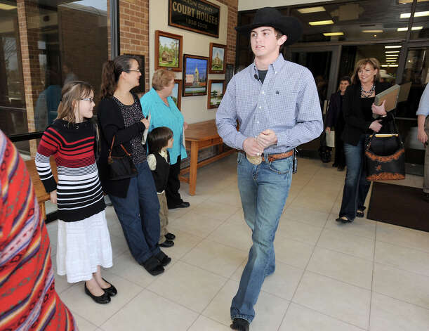 Cody Teel walks through the Hardin County Courthouse on Tuesday. The word champion bull rider returned to Kountze to be recognized by the town. Photo taken Tuesday, March 5, 2013 Guiseppe Barranco/The Enterprise Photo: Guiseppe Barranco, STAFF PHOTOGRAPHER / The Beaumont Enterprise