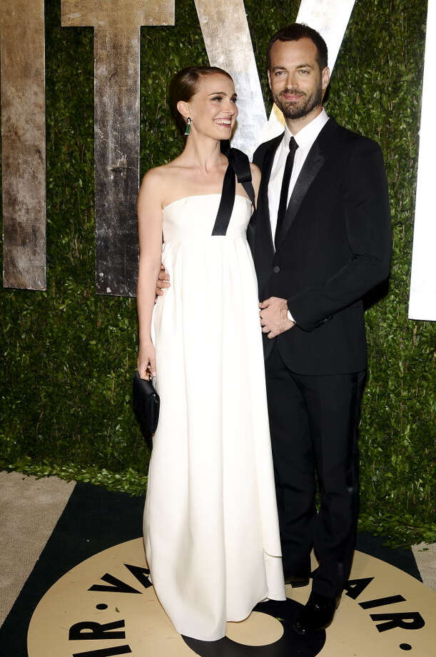 Natalie Portman shows up with her husband, Benjamin Millepied in a simple white dress with a black accent. Easy to find at any dress store or even a bridal shop! (Axel Koester/The New York Times)