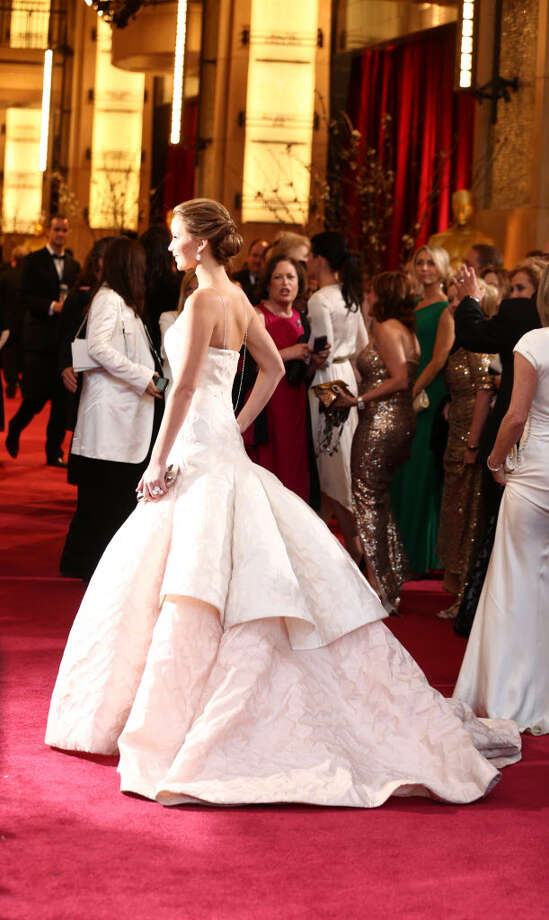 Jennifer Lawrence wows the crowd with her off white ball gown. If you're going for the princess effect this year, this is the type of dress that will accomplish that. (Photo by Matt Sayles/Invision/AP)