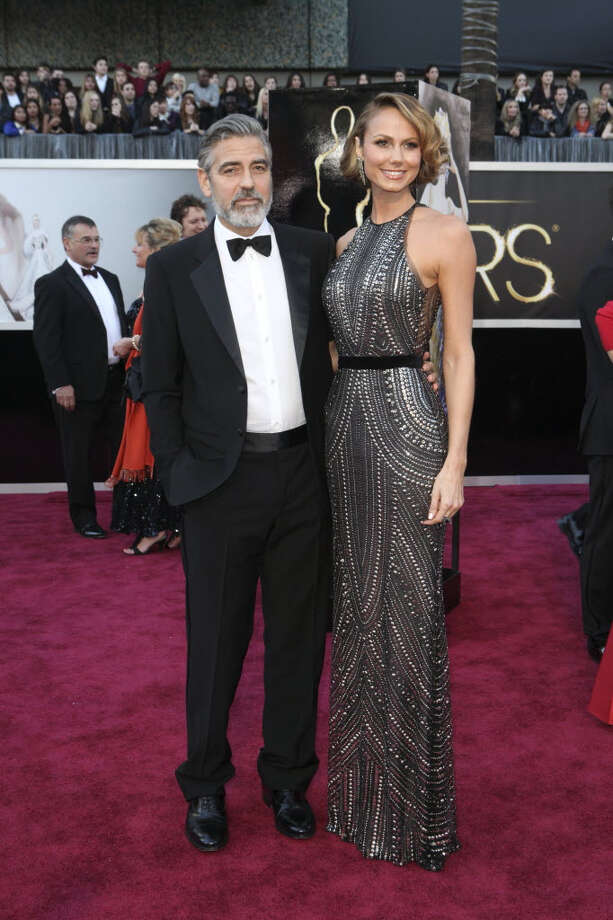 George Clooney accompanies actress Stacy Keibler. She wears a black and silver halter dress. If you've got long legs and a long torso, this is the dress for you! (Josh Haner/The New YorkTimes)