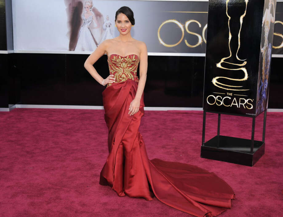 Olivia Munn wears a bold with gold detail in the top. These colors are great for brunettes. (Photo by John Shearer/Invision/AP)