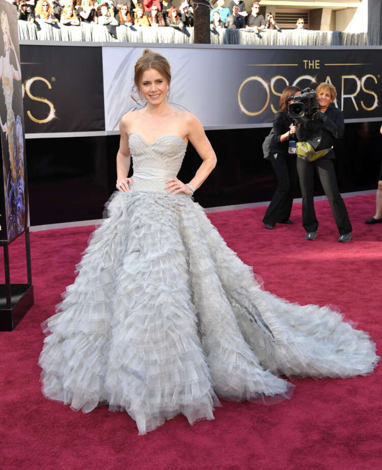 Amy Adams is beautiful in her gray ballgown with a textured bottom and corset top. This dress is sure to be a show stopper on anyone. (Photo by John Shearer/Invision/AP)