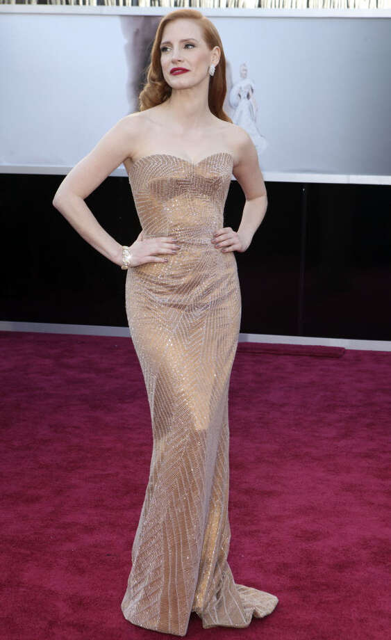 Jessica Chastain looks chic in her gold dress. This look can also be worn with big statement earrings, a smokey eye and nude lipstick.  (Josh Haner/The New York Times)