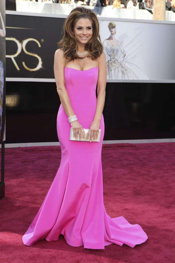Maria Menounos is pretty in pink with her simple down and voluptuous hair. Her rockin necklace paired with her clutch makes the look absolutely perfect. (Josh Haner/The New York Times)