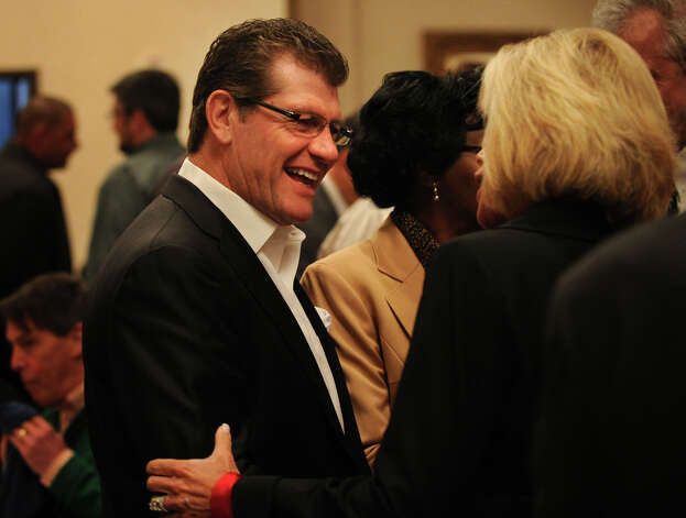 UCONN women's basketball Coach Geno Auriemma chats with incoming St. Vincent's Foundation executive director Lyn McCarthy, of Easton, during the annual Swim Across the Sound fundraising breakfast at the Holiday Inn in Bridgeport, Conn., on Wednesday, March 6, 2013. Photo: Brian A. Pounds / Connecticut Post