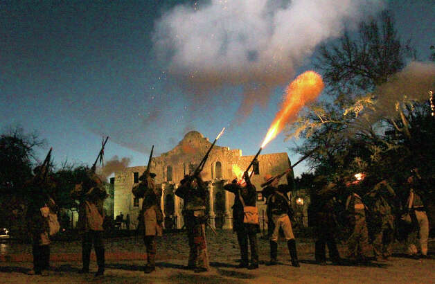 "Members of the San Antonio Living History Association fire muskets Wednesday March 6, 2013 in front of the Alamo during the ""Dawn at the Alamo"" ceremony on the 177th anniversary of the battle for Texas independence. About 300 to 500 Mexican troops are said to have been killed or wounded in the battle and at least 189 Alamo defenders died in the battle or were executed. Photo: JOHN DAVENPORT, San Antonio Express-News / ©San Antonio Express-News/Photo Can Be Sold to the Public"