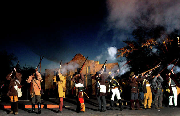"Members of the San Antonio Living History Association fire muskets Wednesday March 6, 2013 in front of the Alamo during the ""Dawn at the Alamo"" ceremony on the 177th anniversary of the battle for Texas independence. About 300 to 500 Mexican troops are said to have been killed or wounded in the battle and at least 189 Alamo defenders died in the battle or were executed. Photo: JOHN DAVENPORT, San Antonio Express-News / SAN ANTONIO EXPRESS-NEWS (Photo can be sold to the public)"