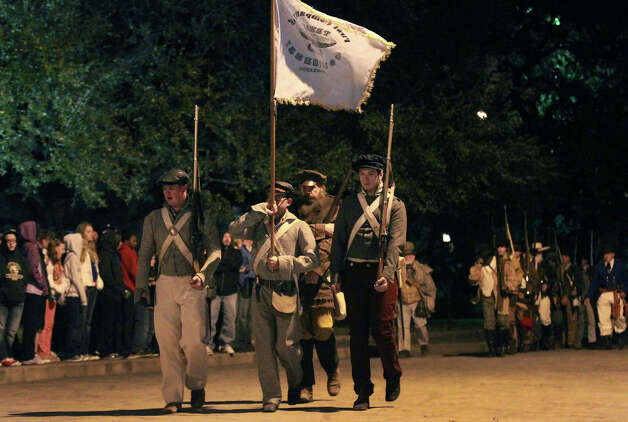 "Members of the San Antonio Living History Association march Wednesday March 6, 2013 in front of the Alamo during the ""Dawn at the Alamo"" ceremony on the 177th anniversary of the battle for Texas independence. About 300 to 500 Mexican troops are said to have been killed or wounded in the battle and at least 189 Alamo defenders died in the battle or were executed. Photo: JOHN DAVENPORT, San Antonio Express-News / ©San Antonio Express-News/Photo Can Be Sold to the Public"