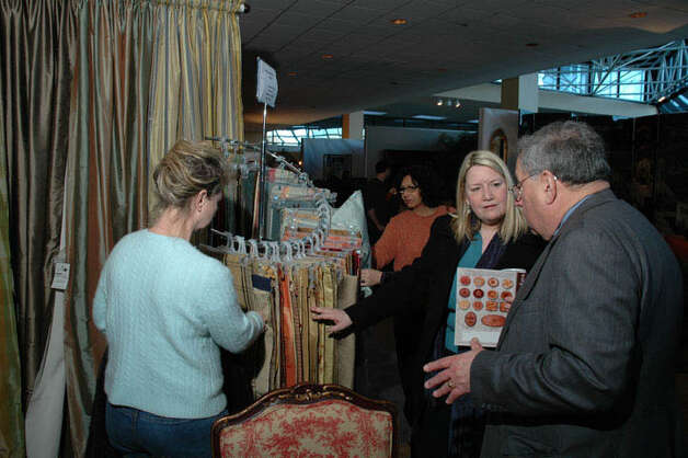 During a previous event Fairfield County Home & Outdoor Living Expo visitors got some ideas for home improvement and redesign. This year's event, the 10th, will take place Saturday and Sunday, March 9 to 10, 2013, at the Stamford Plaza Hotel, Stamford, Conn. For more information, visit http://www.ctexpos.com. Photo: Contributed Photo