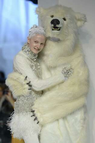 A model walks the runway during the Moncler Gamme Rouge Fall/Winter 2013 Ready-to-Wear show as part of Paris Fashion Week. Photo: Venturelli, Getty Images / 2013 Venturelli