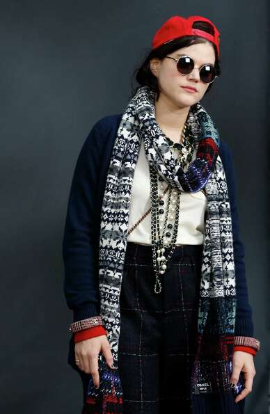 Totally too cool for school: French singer and actress Soko poses on as she arrives to attend Chanel