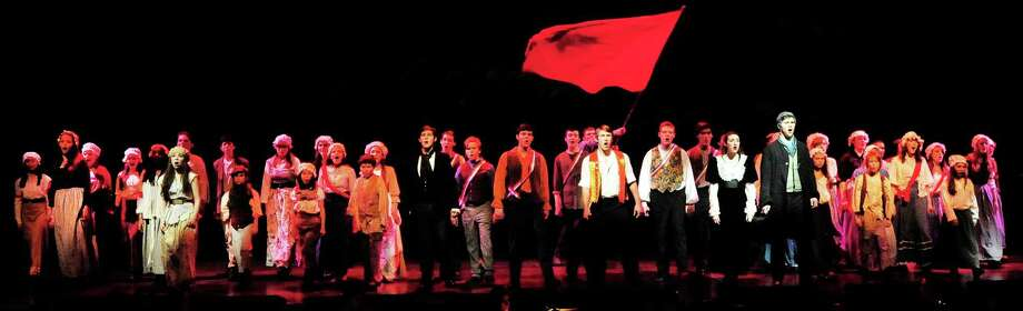 The cast fills the stage calling for revolution in the Ridgefield High School production of Les Miserables, in Conn. Tuesday, March 5, 2013 Photo: Michael Duffy / The News-Times