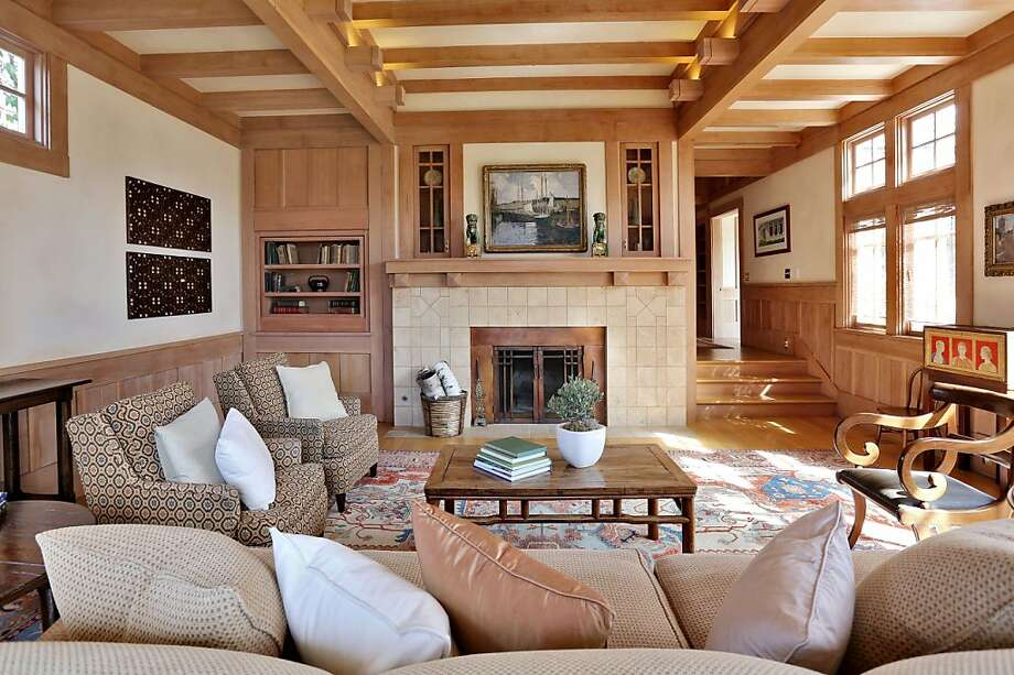 A brick fireplace serves as the centerpiece of the living room. Photo: Liz Rusby, The Grubb Co.