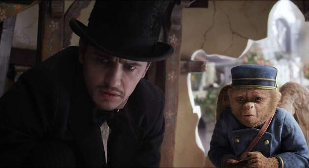 "This film image released by Disney Enterprises shows James Franco, as Oz, left, and the character Finley, voiced by Zach Braff, in a scene from ""Oz the Great and Powerful."""