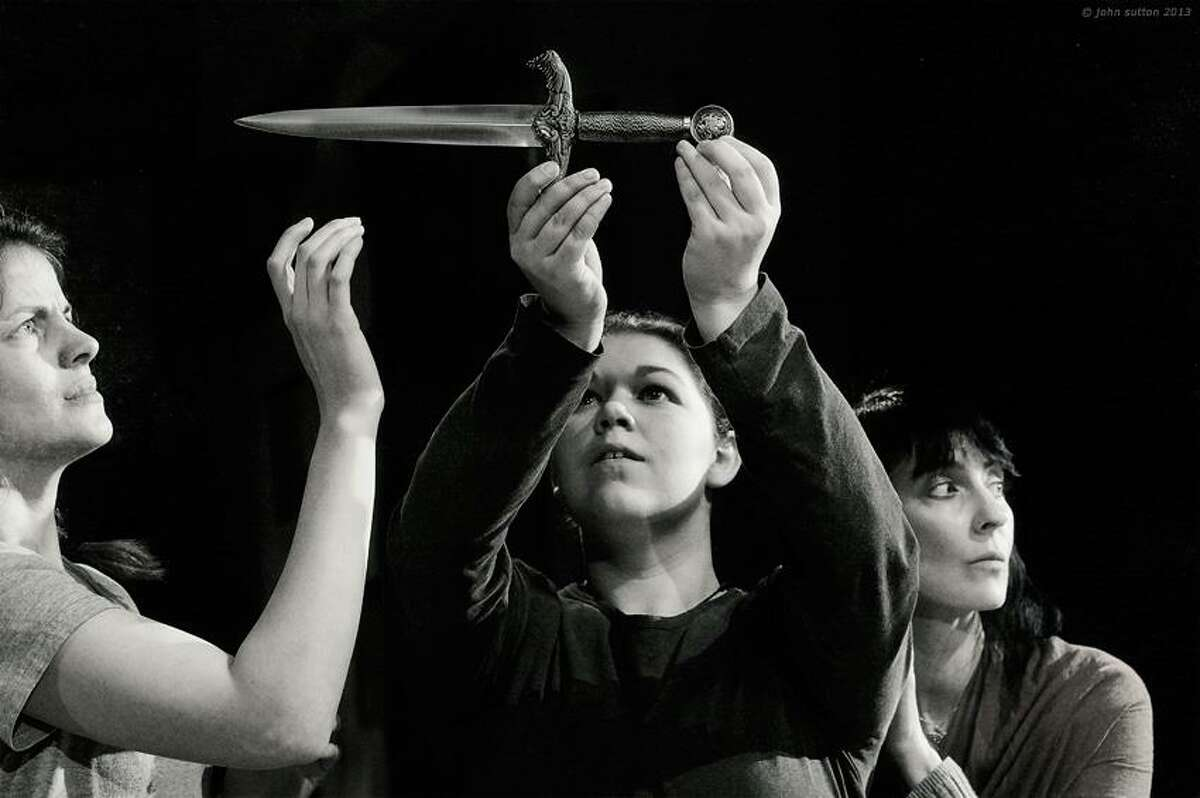 From left, Myka Plunkett, Catherine Seeley, Colleen Lovett examine a knife in the Theater Company at Hubbard Hall's staging of ?Macbeth.? (Photos by John Sutton)