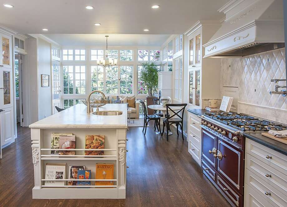 The kitchen was completely remodeled and now features a center island, recessed lighting and six-burner cooktop. Photo: Scott Fitzgerrell