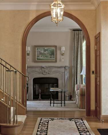 Mahogany archways can be found throughout the home. Photo: Scott Hargis, Scott Hargis Photography