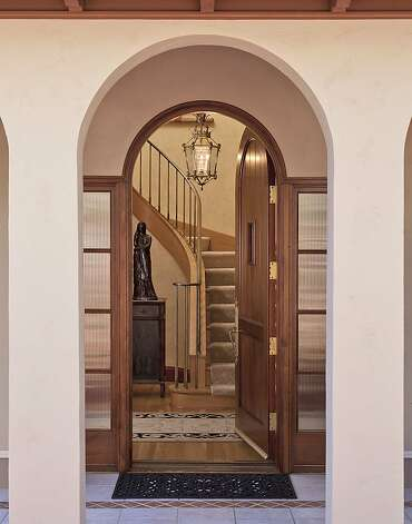 A mahogany front door opens to a two-story foyer. Photo: Scott Hargis, Scott Hargis Photography