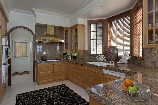 The kitchen has a service entrance near the laundry area and pantry. Photo: Scott Hargis, Scott Hargis Photography