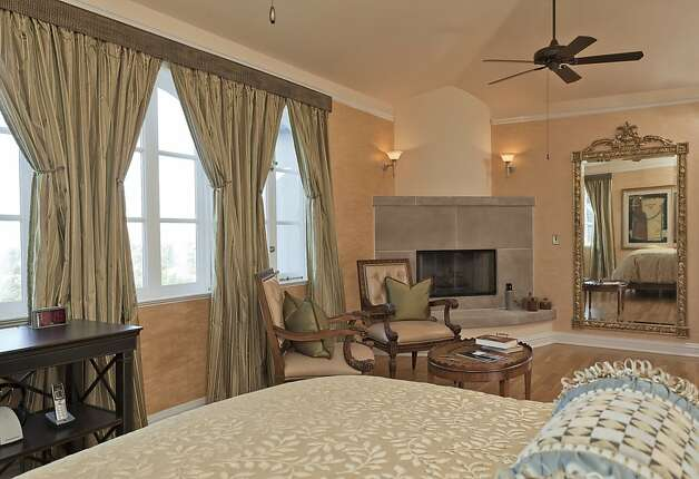 The master suite is found in the south wing of the home and has a fireplace and hearth. Photo: Scott Hargis, Scott Hargis Photography