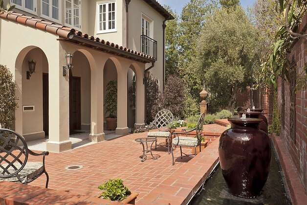 Fountains in the courtyard provide a tranquil atmosphere outside the home. Photo: Scott Hargis, Scott Hargis Photography