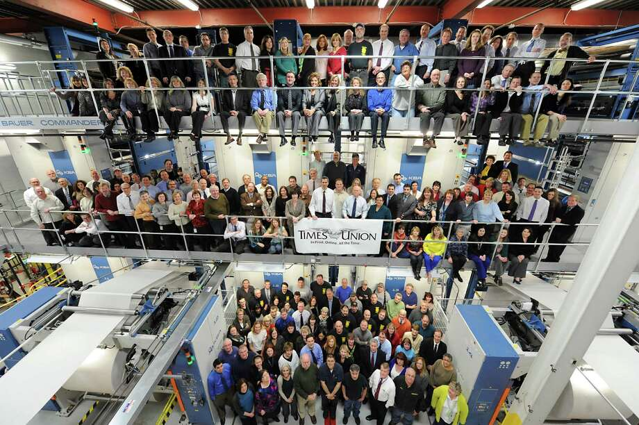 Times Union employees stand in front of the new press at the Times Union on Tuesday March 5, 2013 in Colonie, N.Y. (Lori Van Buren / Times Union) Photo: Lori Van Buren, Times Union / 00021279A