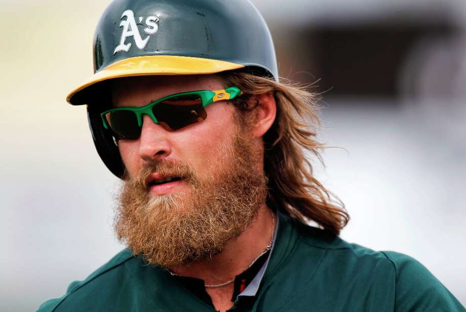 Josh Reddick walks back to the dugout after a ground out as Oakland  went on to beat the WBC team Italy 4-3  at Phoenix Municipal Stadium during spring training action on Tuesday Mar. 5, 2013, in Phoenix, Az. Photo: Michael Macor, The Chronicle / ONLINE_YES