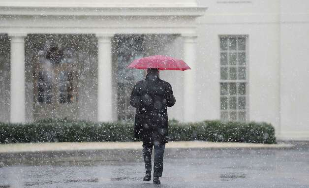 WASHINGTON, DC - MARCH 6:  (AFP OUT) A White House staffer walks to the West Wing during a snow storm at the White House March 6, 2013 in Washington, DC. The snow forced all major school systems in the area to close, including today's White House press briefing   (Photo by Olivier Douliery-Pool/Getty Images) Photo: Pool