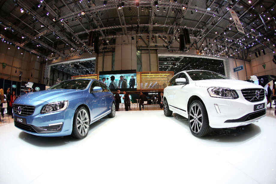 A Volvo V60, left, and a XC60 automobile, produced by Volvo Cars and owned by Zhejiang Geely Holding Group Co., are seen on display on the first day of the 83rd Geneva International Motor Show in Geneva, Switzerland, on Tuesday, March 5, 2013. This year's show opens to the public on Mar. 7, and is set to feature more than 100 product premiers from the world's automobile manufacturers. Photographer: Chris Ratcliffe/Bloomberg Photo: Chris Ratcliffe, Bloomberg / Copyright 2013 Bloomberg Finance LP, All Rights Reserved.